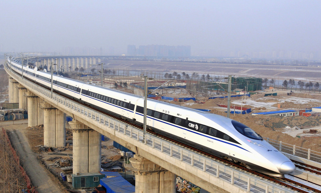 In this photo released by China's Xinhua news agency, a bullet train passes over Yongdinghe Bridge in Beijing Wednesday, Dec. 26, 2012. China has opened the world's longest high-speed rail line, which runs 2,298 kilometers (1,428 miles) from the country's capital in the north to Guangzhou, an economic hub in the Pearl River delta in southern China. (AP Photo/Xinhua, Jiao Hongtao) NO SALES 12272012xNEWS 12272012xBRIEFING